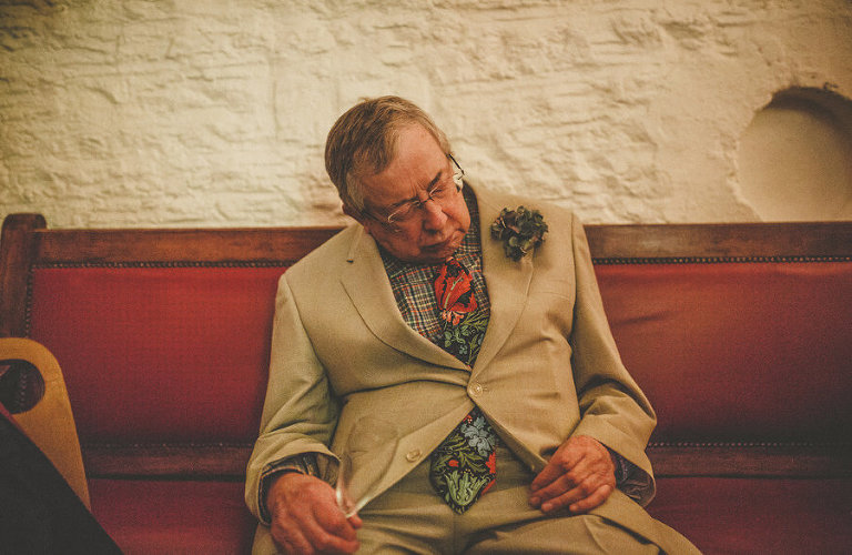 The brides father sleeps on a bench at Silk Mill Studios