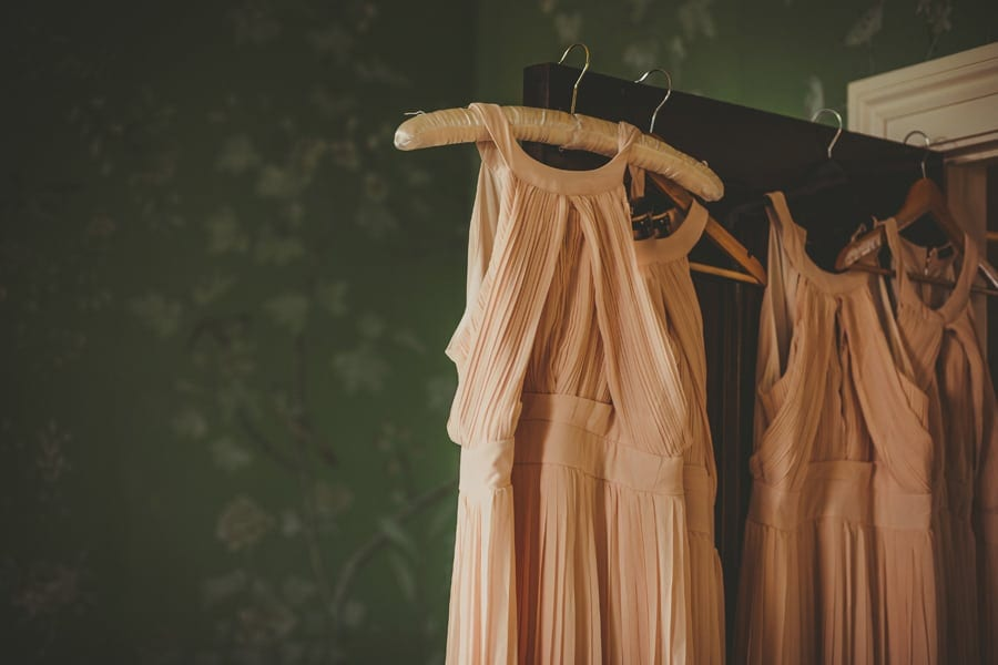 The brides dresses hang from the door in the Master bedroom