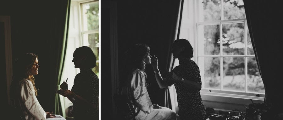 The bride sits next to a window in the Master bedroom