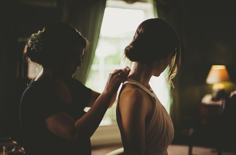A bridesmaid gets ready in the Master bedroom