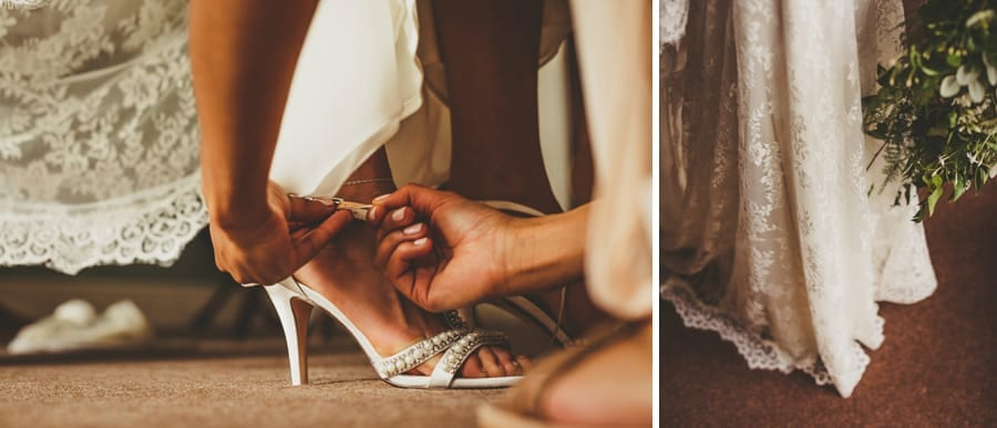 A bridesmaid fastens the buckle on the brides new shoes