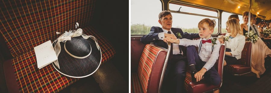 A little boy sits on the bus and a wedding hat is left on the seat of the wedding bus