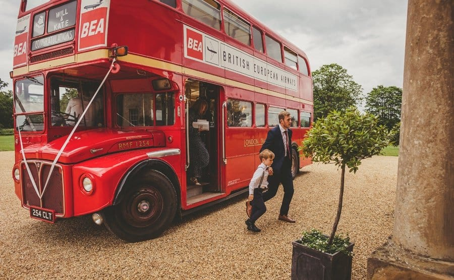 Wedding guests arrive at Stubton Hall and walk off the wedding bus
