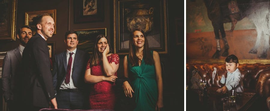 Wedding guests laugh with each other