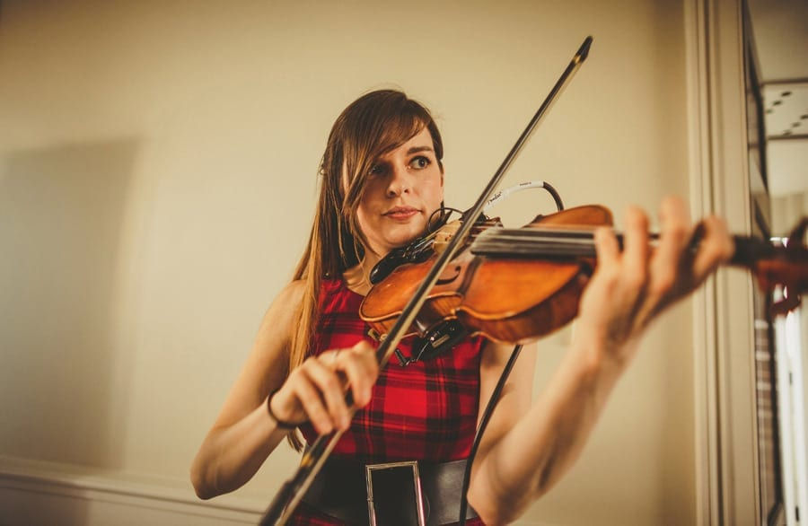 A violinist plays during the ceilidh