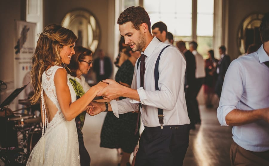 The bride and groom dance together during the ceilidh