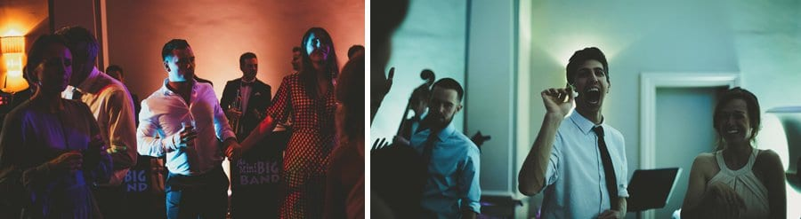 A wedding guest throws a flower at a friend on the dancefloor