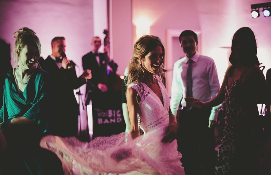 The bride dances with her wedding guests on the dancefloor at Stubton Hall