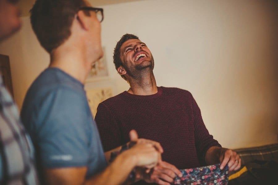 An usher laughs at a joke
