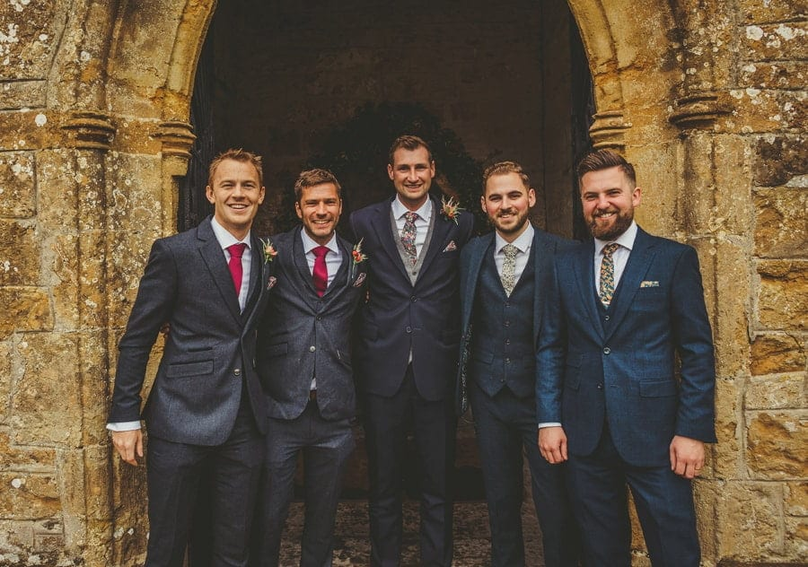 The groom and his ushers pose for a photograph outside the Church