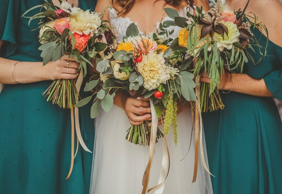 The bride and bridesmaids bouquets outside the Church in Dorset