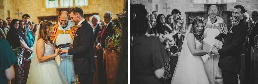 The bride and groom exchange rings in the Church during the wedding ceremony