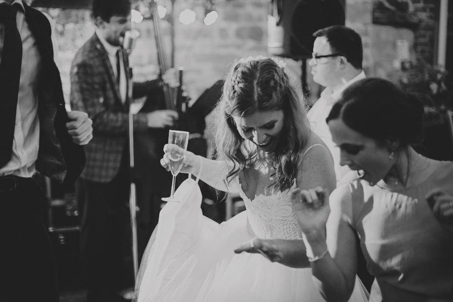 The bride dancing with friends on the dancefloor