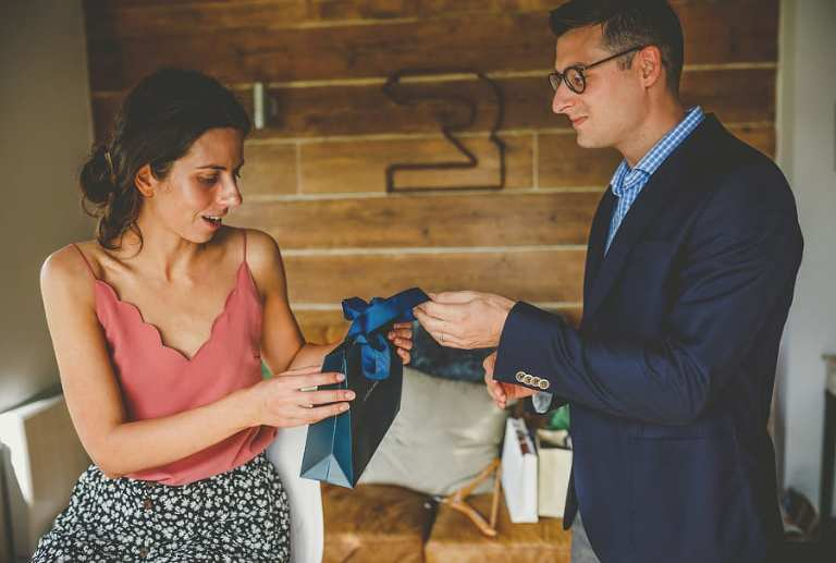 A man gives the bride a wedding gift in the cottage