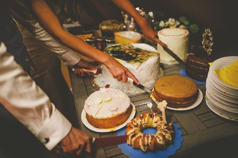 The bride and groom cut the wedding cakes in the tipi at yurt retreat