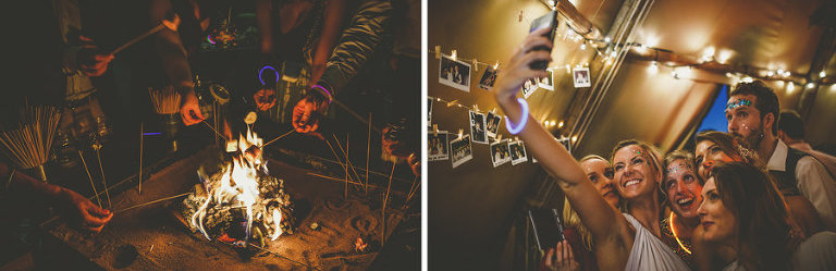 A bridesmaid holds a mobile phone in her hand and takes a photograph of herself and her friends in the tipi at yurt retreat in Crewkerne in Somerset