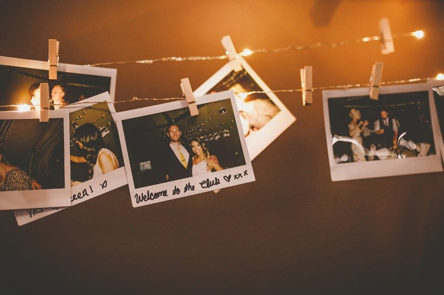 Polaroid photographs hang on string in the tipi