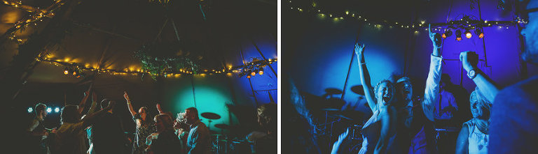 Wedding guests put their arms in the air on the dancefloor in the tipi and dance to a song played by the wedding band