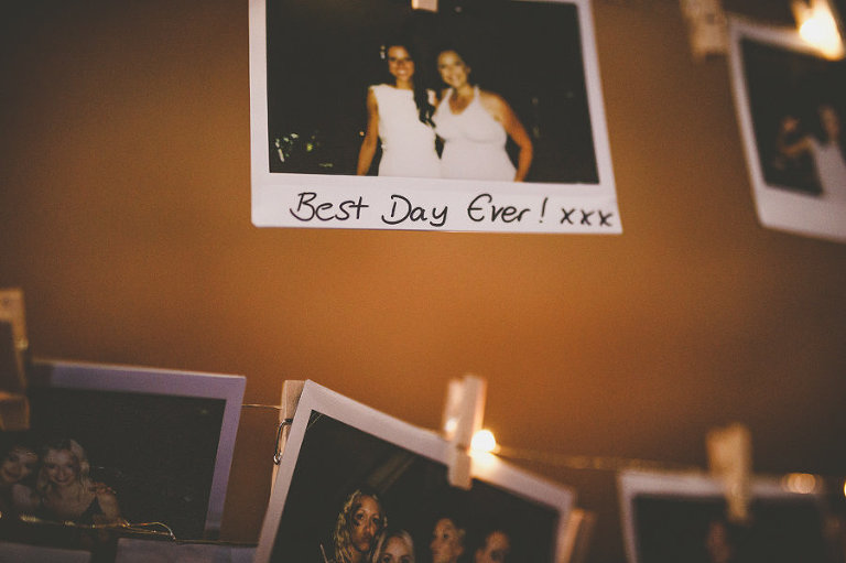 A polaroid photograph hangs from a piece of string in the tipi