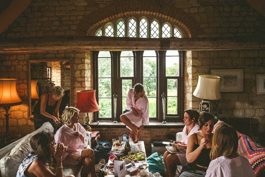 The bridal party getting ready in a barn