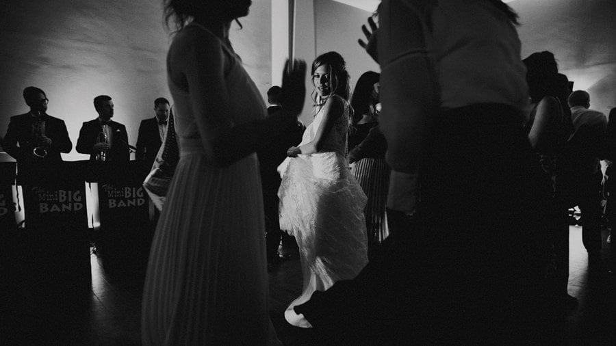 The bride dances on the dancefloor with friends
