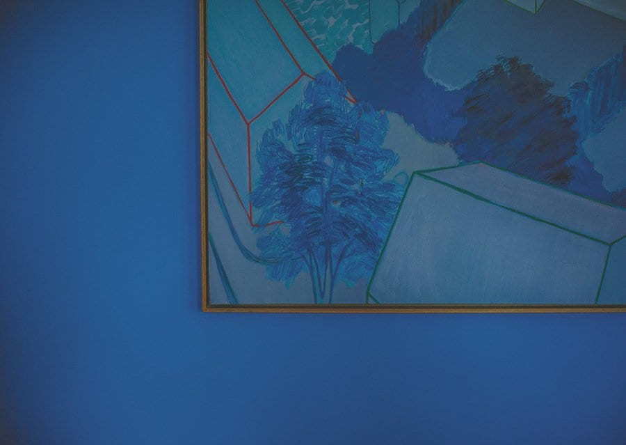 A painting hangs on the wall at Cowley Manor in Cheltenham