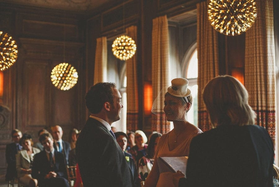 The bride and groom stand face to face and look at each other at Cowley Manor Hotel