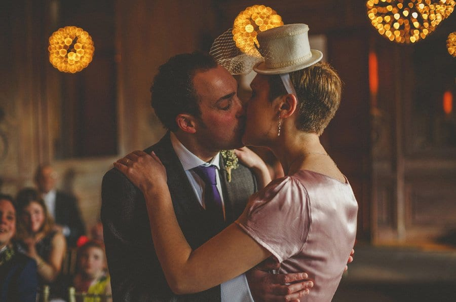 The bride and groom embrace and kiss each other during the wedding ceremony at Cowley Manor