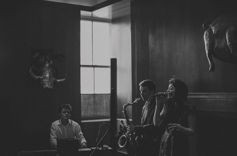The wedding band perform a song for the wedding guests at Cowley Manor Hotel
