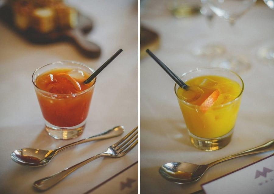 Cocktail drinks with black straws inside them