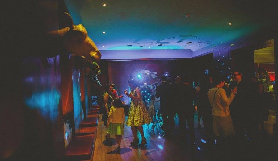 Wedding guests dancing on the dance floor at Cowley Manor