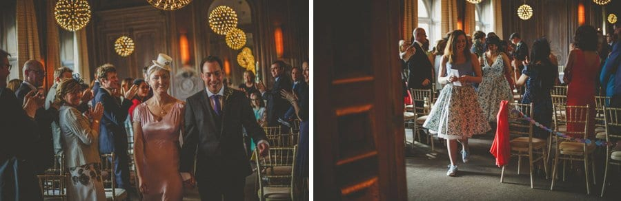 The bride and groom walk down the aisle at Cowley Manor