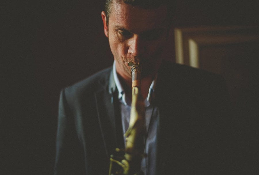 A member of the wedding band plays a saxophone