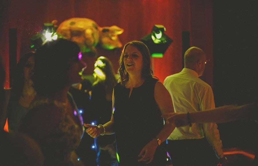 A lady dances with her friend on the dancefloor at Cowley Manor