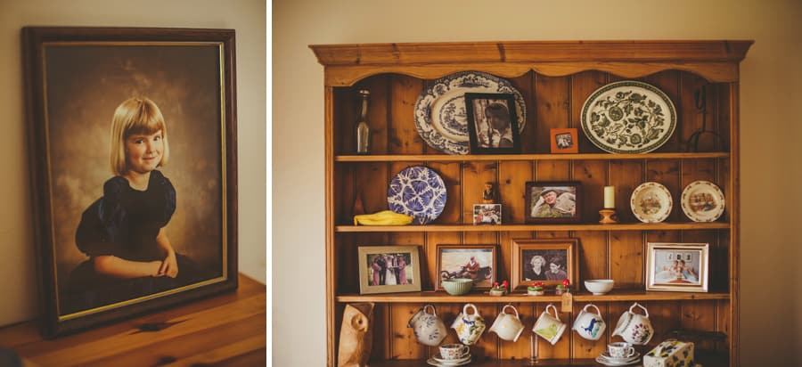 A wooden shelf cabinet with ornaments and photographs displayed
