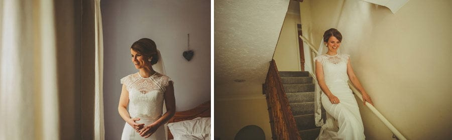 The bride walks down the stairs of her parents house