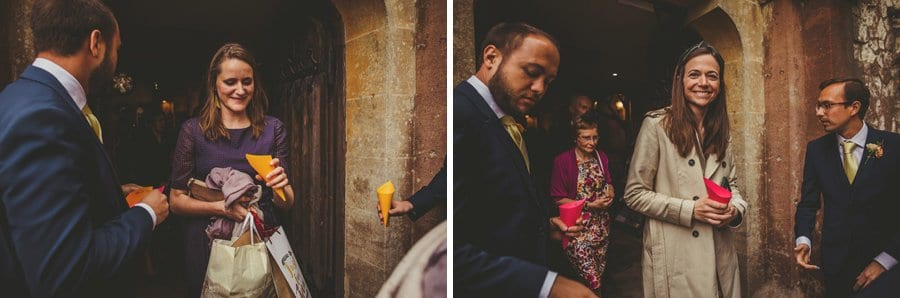 Wedding guests leaving the Church pick up confetti from a wicker basket