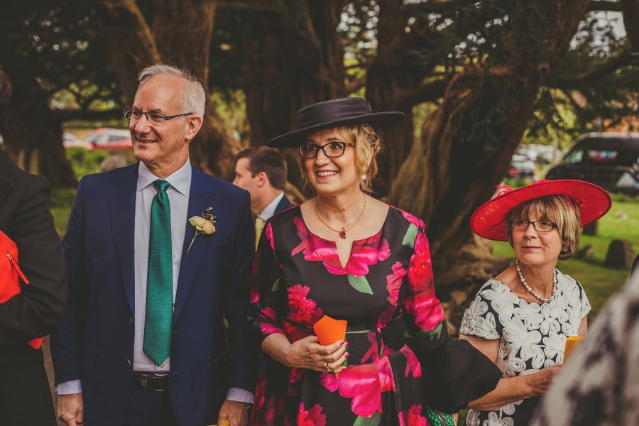 Wedding guests stand outside the Church and wait for the bride and groom