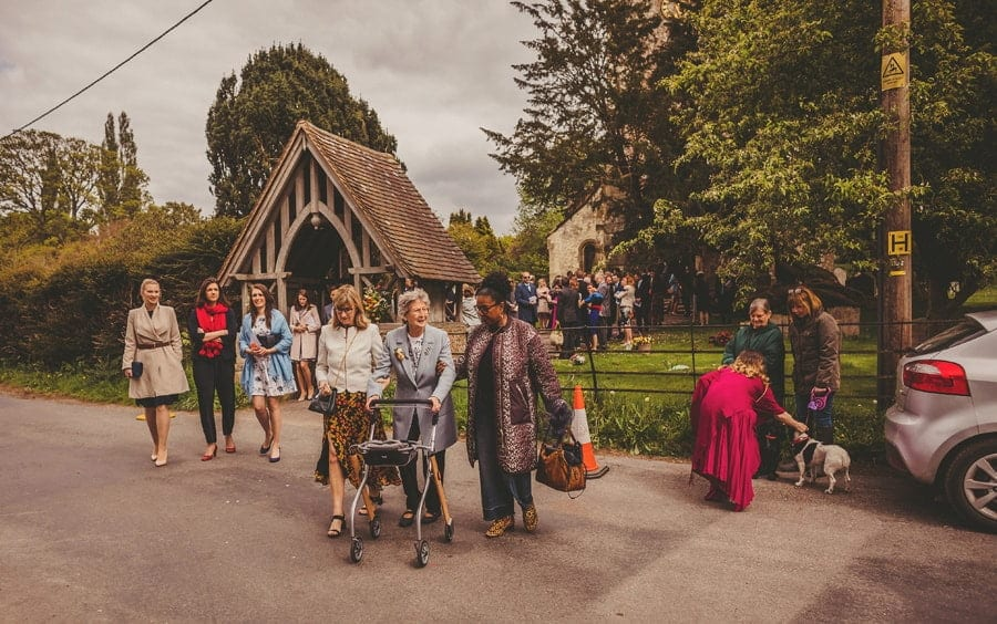 Wedding guests walk away from the church