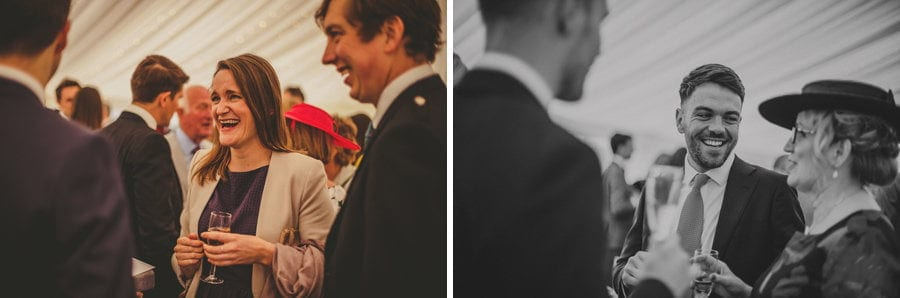 Wedding guests chat to each other in the marquee