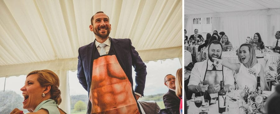 A wedding guest puts on an apron in the marquee
