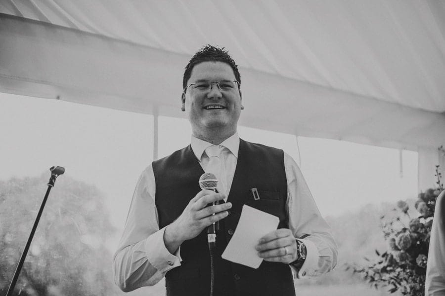 The best man speaks in the marquee