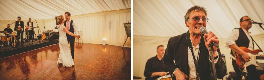 The bride and groom dance together on the dancefloor in the marquee