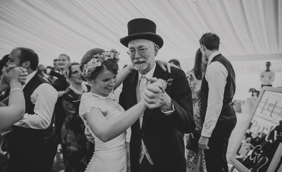 The bride and her father dance together in the marquee