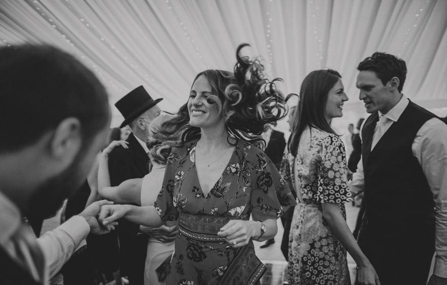 A wedding guest dances with her husband on the dancefloor