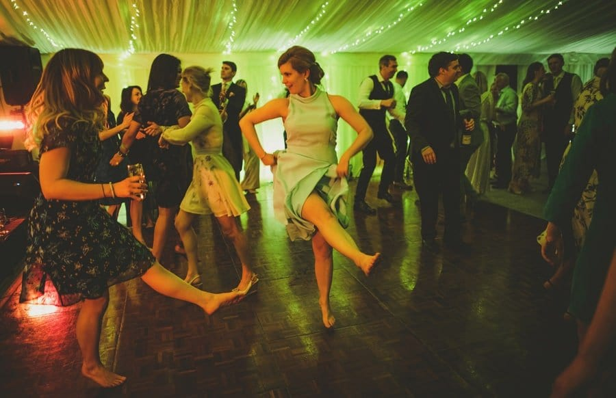 The brides sister lifts up her skirt and kicks her leg out on the dancefloor