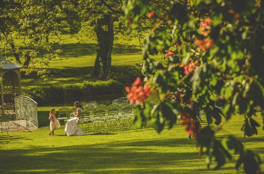 The brides sister with her daughter in the garden at Longstowe Hall