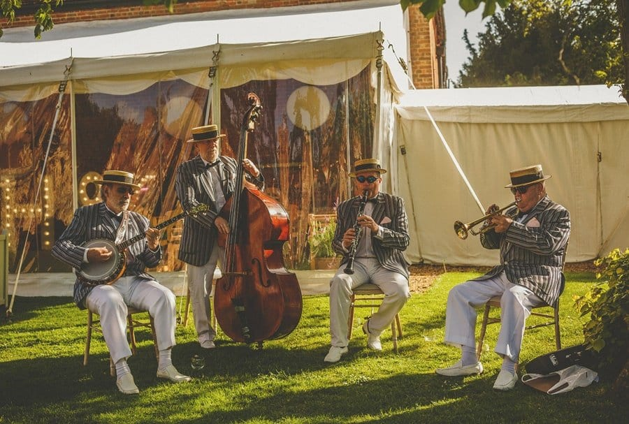 The wedding band in the garden of Longstowe Hall