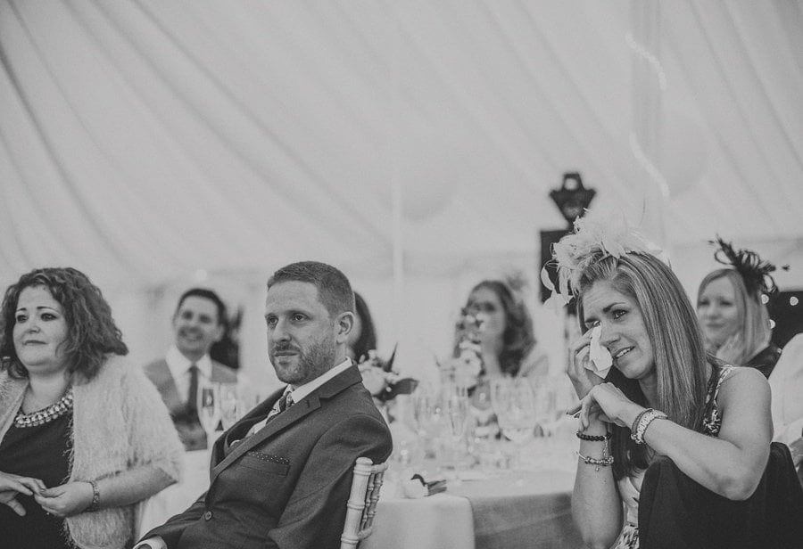 A wedding guest cries as she listens to the grooms speech in the marquee at Longstowe Hall