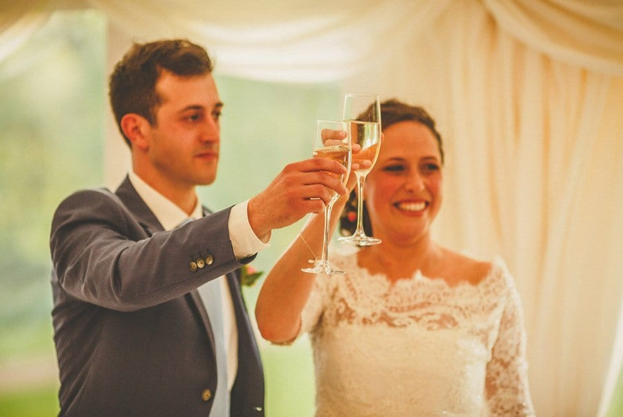 The bride and groom celebrate with a flute of champagne